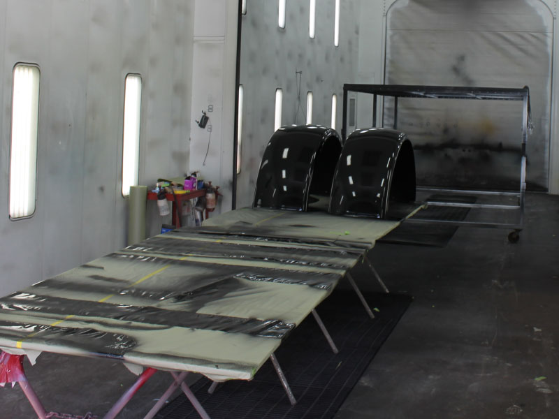 Semi part being painted black in Final Finish paint shop
